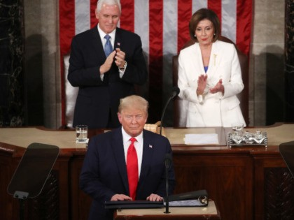 WASHINGTON, DC - FEBRUARY 04: House Speaker Rep. Nancy Pelosi (D-CA) and Vice President Mike Pence applaud as President Donald Trump steps to the lectern for the State of the Union address in the chamber of the U.S. House of Representatives on February 04, 2020 in Washington, DC. President Trump …