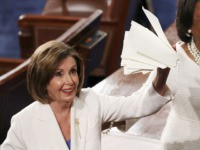WASHINGTON, DC - FEBRUARY 04: House Speaker Rep. Nancy Pelosi (D-CA) (L) holds up the ripped up copy of President Donald Trump's speech after the State of the Union address in the chamber of the U.S. House of Representatives on February 04, 2020 in Washington, DC. President Trump delivers his …
