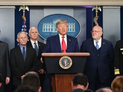 US President Donald Trump (C) speaks at a news conference with members of the Centers for Disease Control and Prevention(CDC) on the COVID-19 outbreak at the White House in Washington, DC on February 29, 2020. - The number of novel coronavirus cases in the world rose to 85,919, including 2,941 …