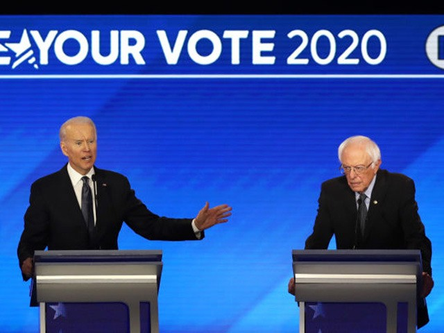 MANCHESTER, NEW HAMPSHIRE - FEBRUARY 07: (L-R) Democratic presidential candidates Sen. Elizabeth Warren (D-MA), former Vice President Joe Biden and Sen. Bernie Sanders (I-VT) participate in the Democratic presidential primary debate in the Sullivan Arena at St. Anselm College on February 07, 2020 in Manchester, New Hampshire. Seven candidates qualified …