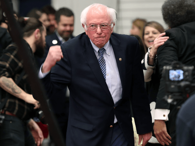 Democratic presidential candidate Sen. Bernie Sanders (I-VT) takes the stage during a primary night event on February 11, 2020 in Manchester, New Hampshire. New Hampshire voters cast their ballots today in the first-in-the-nation presidential primary. (Photo by Joe Raedle/Getty Images)
