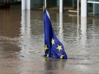HEREFORD, ENGLAND - FEBRUARY 17: An EU flag flying outside a house is partially covered by the flooding of the River Wye following Storm Dennis on February 17, 2020 in Hereford, England. Storm Dennis is the second named storm to bring extreme weather in a week and follows in the …