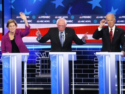 LAS VEGAS, NEVADA - FEBRUARY 19: Democratic presidential candidate Sen. Bernie Sanders (I-VT) (C) makes a point as Sen. Elizabeth Warren (D-MA) and former Vice President Joe Biden (R) raise their hands during the Democratic presidential primary debate at Paris Las Vegas on February 19, 2020 in Las Vegas, Nevada. …