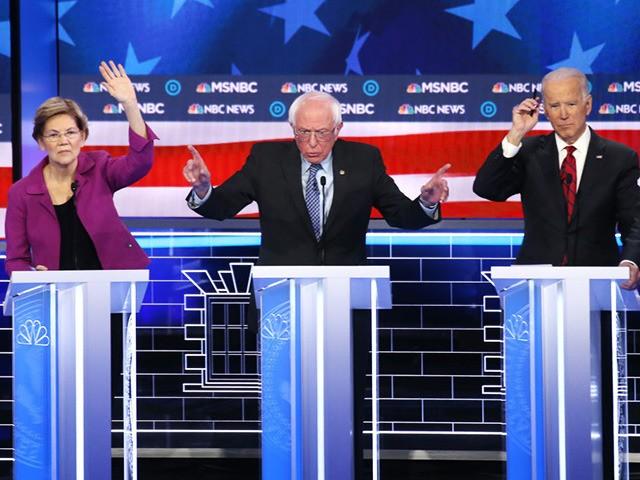 LAS VEGAS, NEVADA - FEBRUARY 19: Democratic presidential candidate Sen. Bernie Sanders (I-VT) (C) makes a point as Sen. Elizabeth Warren (D-MA) and former Vice President Joe Biden (R) raise their hands during the Democratic presidential primary debate at Paris Las Vegas on February 19, 2020 in Las Vegas, Nevada. …
