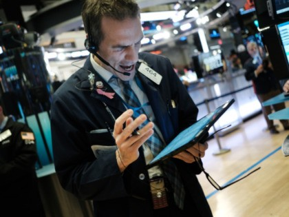 NEW YORK, NEW YORK - FEBRUARY 24: Traders work on the floor of the New York stock Exchange (NYSE) on on February 24, 2020 in New York City. Stocks fell over 1000 points on Monday as global concerns grow about the economic impact of the Coronavirus. (Photo by Spencer Platt/Getty …
