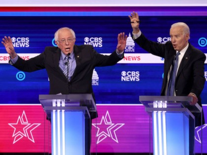 CHARLESTON, SOUTH CAROLINA - FEBRUARY 25: Democratic presidential candidate Sen. Bernie Sanders (I-VT) (L) speaks as former Vice President Joe Biden reacts during the Democratic presidential primary debate at the Charleston Gaillard Center on February 25, 2020 in Charleston, South Carolina. Seven candidates qualified for the debate, hosted by CBS …