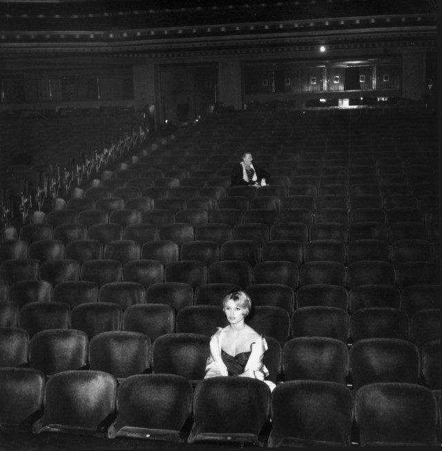 circa 1955: French actor Brigitte Bardot sits in a nearly empty movie theater. (Photo by Hulton Archive/Getty Images)