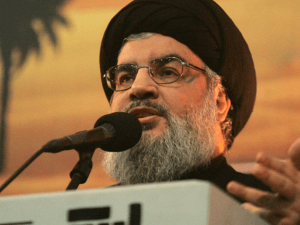 The head of Lebanon's militant Shiite Muslim movement Hezbollah, Hassan Nasrallah speaks in a rare public appearance addressing thousands of his supporters ahead of the Shiite Ashura commemorations on November 3, 2014 the Lebanese capital's southern suburbs. Nasrallah had not been seen in public since July, when he attended a …