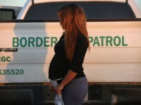 An immigrant from El Salvador, seven months pregnant, she said, stands next to a U.S. Border Patrol truck after turning herself in to border agents on December 7, 2015 near Rio Grande City, Texas. Many pregnant women, according to Border Patrol agents, cross illegally into the U.S. late into their …