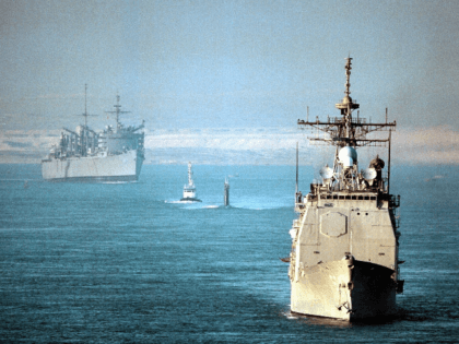 The USS Normandy (Front), the submarine USS Annapolis (Center), and the support ship USS Seattle (Rear), all part of the USS George Washington battle group, cross the Suez Canal 16 November in this photo provided by the US Navy. The USS George Washington battle group will join the USS Nimitz …