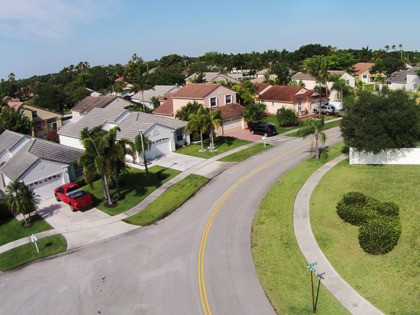 Middle class neighborhood street in Florida aerial view