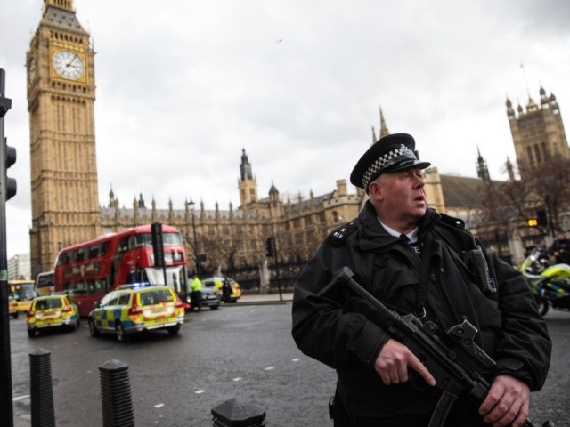 LONDON, ENGLAND - MARCH 22: An armed police officer stands guard near Westminster Bridge and the Houses of Parliament on March 22, 2017 in London, England. A police officer has been stabbed near to the British Parliament and the alleged assailant shot by armed police. Scotland Yard report they have …