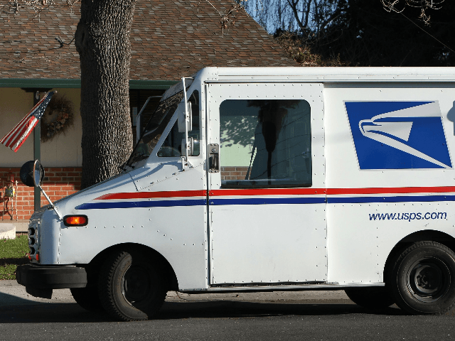 US Postal Service letter carrier Dennis Stecz walks back to his truck after delivering a package January 28, 2009 in San Lorenzo, California. The US Postal Service asked the US Congress for permission to discontinue mail delivery one additional day a week in an effort to make up financial losses. …