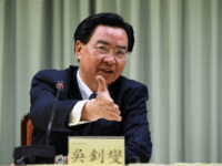 """Taiwan Foreign Minister Joseph Wu gestures during a press conference in Taipei on May 1, 2018. - Taiwan said it was """"deeply upset"""" after the Dominican Republic, one of its few remaining official allies, established diplomatic relations with China and cut ties with the island. (Photo by SAM YEH / …"""