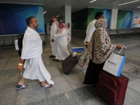Muslim pilgrims go through passport control upon their arrival at Jeddah airport on July 14,2018, prior to the start of the annual Hajj pilgrimage in the holy city of Mecca. - The Hajj, the largest annual pilgrimage in the world, is the fifth pillar of Islam, a religious duty that …