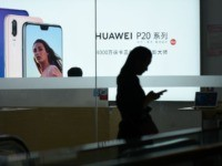 A Huawei poster is displayed in a Huawei store in Beijing on August 7, 2018. - Despite being essentially barred from the critical US market, Huawei surpassed Apple to become the world's number two smartphone maker in the second quarter of this year and has market leader Samsung in its …