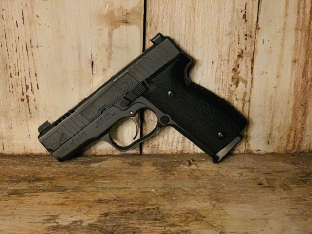 The Kahr Arms 25th Anniversary K9 is an 9mm, American-made pistol that comes standard with Tru-Glo tritium night sights, Hogue aluminium grips, and a Sniper Grey Cerakote finish.