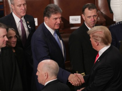President Donald Trump greets Joe Manchin (D-WV) after the State of the Union address in the chamber of the U.S. House of Representatives at the U.S. Capitol Building on February 5, 2019 in Washington, DC. President Trump's second State of the Union address was postponed one week due to the …