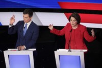 DES MOINES, IOWA - JANUARY 14: Sen. Amy Klobuchar (D-MN) makes a point as former South Bend, Indiana Mayor Pete Buttigieg raises his hand during the Democratic presidential primary debate at Drake University on January 14, 2020 in Des Moines, Iowa. Six candidates out of the field qualified for the …