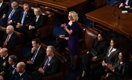 US Senator Kyrsten Sinema (D-AZ) claps during the State of the Union address at the US Capitol in Washington, DC, on February 4, 2020. (Photo by Brendan Smialowski / AFP) (Photo by BRENDAN SMIALOWSKI/AFP via Getty Images)