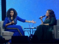 "Michelle Obama, left, and Oprah Winfrey speak onstage at ""Oprah's 2020 Vision: Your Life in Focus"" tour at the Barclays Center on Saturday, Feb. 8, 2020, in New York. (Photo by Brad Barket/Invision/AP)"