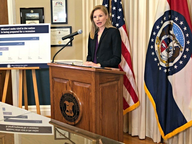 Missouri Auditor Nicole Galloway speaks to reporters Tuesday, Oct. 15, 2019, at her office in the state Capitol in Jefferson City, Mo. Galloway said Missouri isn't saving enough money for a recession. She recommended that lawmakers boost the Budget Reserve Fund to the maximum allowed under the state constitution and …