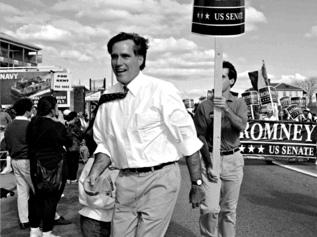 Republican U.S. Senatorial candidate Mitt Romney greets supporters at the Columbus Day parade in Worcester, Mass., Monday, Oct. 10, 1994. Romney was facing U.S. Senator Edward Kennedy, D-Mass., in November's election. (AP Photo/C.J. Gunther)