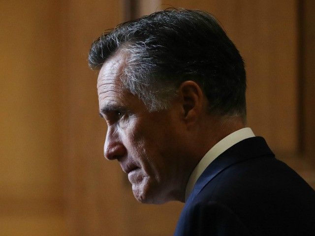 Sen. Mitt Romney (R-UT) stands in a hallway near the Senate chamber in the U.S. Capitol on January 24, 2020 in Washington, DC. Impeachment trial proceedings against President Donald Trump have resumed today. (Photo by Mario Tama/Getty Images)