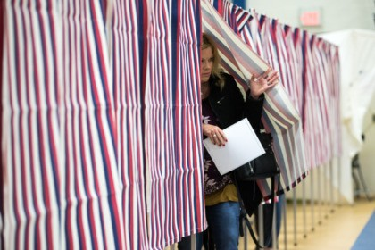 CONCORD, NH - FEBRUARY 11: A voter exits the voting booth after filling out their ballot at the Broken Ground School during the presidential primary on February 11, 2020 in Concord, New Hampshire. (Photo by Scott Eisen/Getty Images)