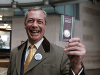 LONDON, ENGLAND - FEBRUARY 02: Brexit Party leader and former MEP, Nigel Farage holds up commemorative 50p Brexit coin as he arrives to appear on the Andrew Marr Show at BBC Television Centre on February 2, 2020 in London, England. (Photo by Hollie Adams/Getty Images)