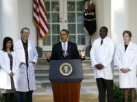 U.S. President Barack Obama speaks as doctors look on in the Rose Garden at the White House on October 5, 2009 in Washington, DC. Obama was meeting doctors from all over the country who are joining him in pushing for health insurance reform. (Photo by Win McNamee/Getty Images)