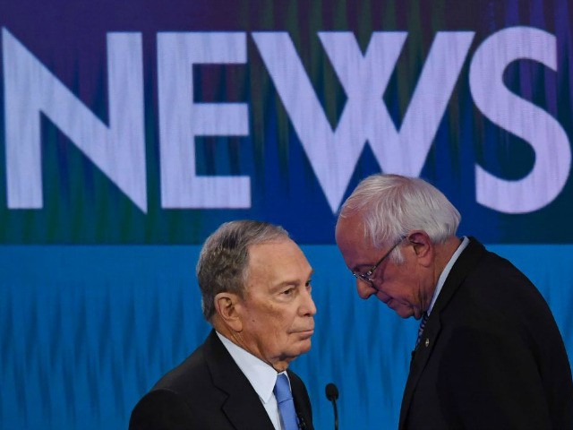 Democratic presidential hopefuls Former New York Mayor Mike Bloomberg (L) and Vermont Senator Bernie Sanders (R) speak during a break in the ninth Democratic primary debate of the 2020 presidential campaign season co-hosted by NBC News, MSNBC, Noticias Telemundo and The Nevada Independent at the Paris Theater in Las Vegas, …