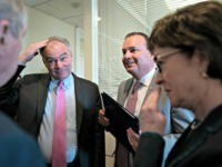Sen. Tim Kaine, D-Va., center left, and Sen. Mike Lee, R-Utah, flanked by Sen. Dick Durbin, D-Ill., left, and Sen. Susan Collins, R-Maine, meet prior to a news conference just after the Senate advanced a bipartisan resolution asserting that President Donald Trump must seek approval from Congress before engaging in …