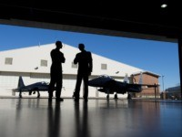 Pilots with the US Air Force stand inside a hangar alongside a F-15 fighter jet and a T-38 Talon trainer jet during the inaugural Trilateral Exercise between the US Air Force, United Kingdom's Royal Air Force and the French Air Force at Joint Base Langley-Eustis in Hampton, Virginia, December 15, …