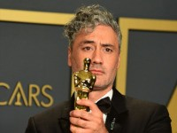"""New Zealand director Taika Waititi poses in the press room with the Oscar for Best Adapted Screenplay for """"Jojo Rabbit"""" during the 92nd Oscars at the Dolby Theater in Hollywood, California on February 9, 2020. (Photo by FREDERIC J. BROWN / AFP) (Photo by FREDERIC J. BROWN/AFP via Getty Images)"""