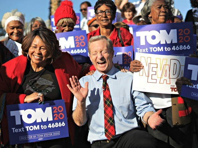 LAS VEGAS, NEVADA - FEBRUARY 14: Democratic presidential candidate Tom Steyer reacts as he poses with supporters during a campaign event at Martin Luther King Jr. Senior Center February 14, 2020 in Las Vegas, Nevada. Steyer continues to campaign for the upcoming Nevada Democratic presidential caucus. (Photo by Alex Wong/Getty …