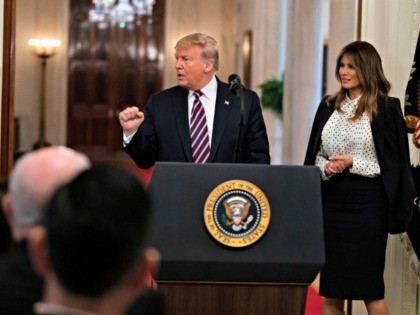 First lady Melania Trump looks on as President Donald Trump pumps his fist after speaking during an event celebrating his impeachment acquittal, in the East Room of the White House, Thursday, Feb. 6, 2020, in Washington. (AP Photo/Evan Vucci)
