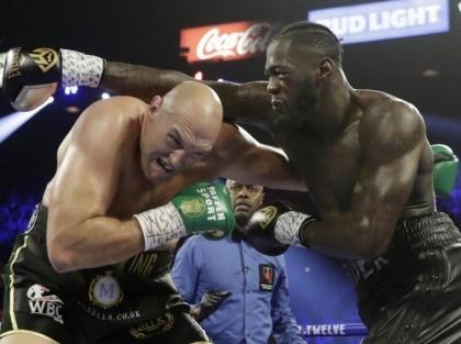Tyson Fury and Deontay Wilder (Isaac Brekken / Associated Press)