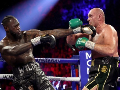 LAS VEGAS, NEVADA - FEBRUARY 22: Tyson Fury (R) and Deontay Wilder exchange punches during their Heavyweight bout for Wilder's WBC and Fury's lineal heavyweight title on February 22, 2020 at MGM Grand Garden Arena in Las Vegas, Nevada. (Photo by Al Bello/Getty Images)