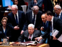 Palestinian president Mahmud Abbas (C) arrives at the UN Security Council at the United Nations headquarters on February 11, 2020 in New York. - Palestinian president Mahmud Abbas on Tuesday told the UN Security Council that the world should reject President Donald Trump's Middle East plan, which he said would …