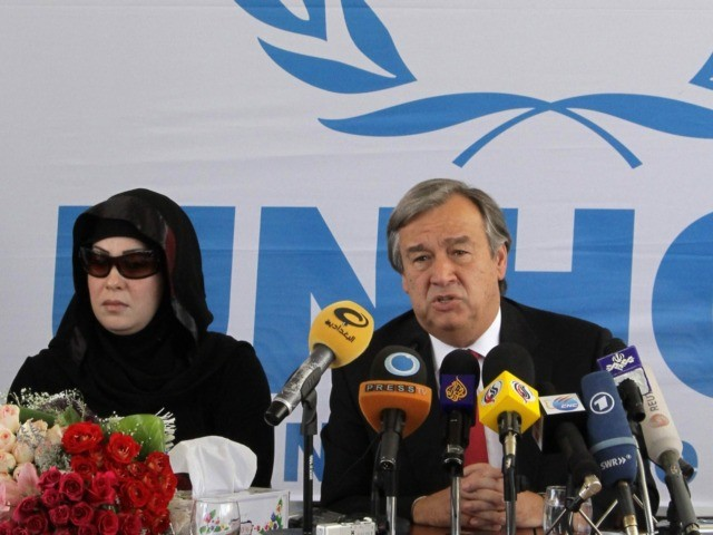 United Nations High Commissioner for Refugees (UNHCR) chief Antonio Guterres speaks during a press conference as Maysoon, the 100,000th Iraqi refugee waiting to immigrate to a third country sits next to him, during a press conference at UNHCR office in Damascus on June 20, 2010. AFP PHOTO/LOUAI BESHARA (Photo credit …
