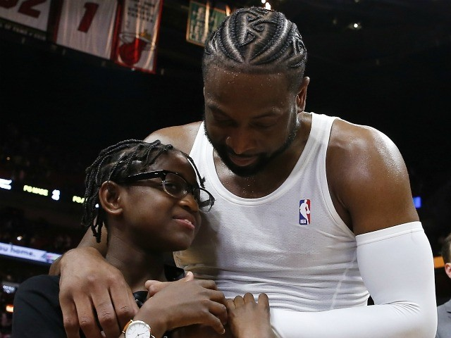 MIAMI, FLORIDA - APRIL 09: Dwyane Wade #3 of the Miami Heat hugs his son, Zion Wade, after his final career home game at American Airlines Arena on April 09, 2019 in Miami, Florida. NOTE TO USER: User expressly acknowledges and agrees that, by downloading and or using this photograph, …