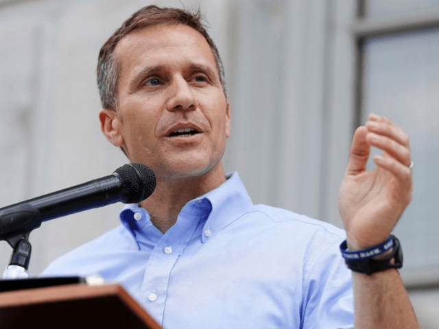 In this May 23, 2017, file photo, Missouri Gov. Eric Greitens speaks to supporters during a rally outside the state Capitol in Jefferson City, Mo. Greitens resigned June 1, 2018, while facing potential House impeachment proceedings over allegations of sexual and political misconduct. A woman with whom Greitens had an …