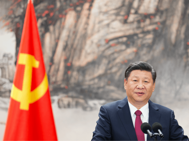 BEIJING, CHINA - OCTOBER 25: Chinese President Xi Jinping speaks at the podium during the unveiling of the Communist Party's new Politburo Standing Committee at the Great Hall of the People on October 25, 2017 in Beijing, China. China's ruling Communist Party today revealed the new Politburo Standing Committee after …