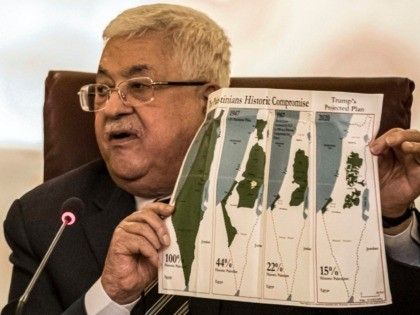Palestinian president Mahmud Abbas holds a placard showing maps of (L to R) historical Palestine, the 1947 United Nations partition plan on Palestine, the 1948-1967 borders between the Palestinian territories and Israel, and a current map of the Palestinian territories without Israeli-annexed areas and settlements, as he attends an Arab …