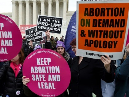 Pro-choice and pro-life activists demonstrate in front of the the US Supreme Court during the 47th annual March for Life on January 24, 2020 in Washington, DC. - Activists gathered in the nation's capital for the annual event to mark the anniversary of the Supreme Court Roe v. Wade ruling …