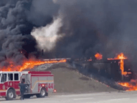 A tanker overturned and caught on fire in the intersection of I-465 and I-70 on Indianapolis' east side on Thursday, Feb. 20, 2020.