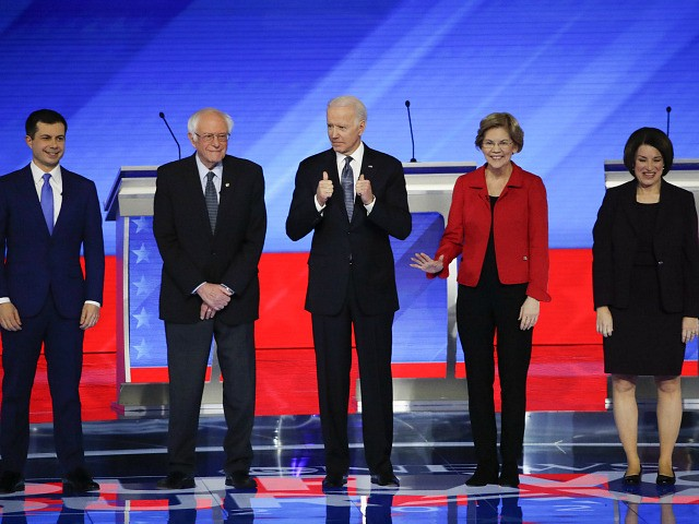From left, Democratic presidential candidates former South Bend Mayor Pete Buttigieg, Sen. Bernie Sanders, I-Vt., former Vice President Joe Biden, Sen. Elizabeth Warren, D-Mass., and Sen. Amy Klobuchar, D-Minn., stand on stage Friday, Feb. 7, 2020, before the start of a Democratic presidential primary debate hosted by ABC News, Apple …