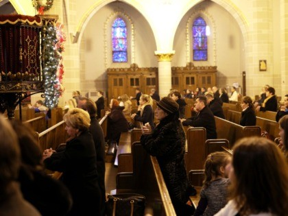 Faithful pray during Sunday Mass at a Polish catholic church in Hamtramck, Michigan, on January 10, 2016. Known in the 20th century as a vibrant center of Polish American life and culture, Hamtramck - located on the outskirts of Detroit, has continued to attract immigrants. AFP PHOTO/JEWEL SAMAD / AFP …