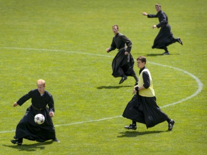 Seminarians of the International Seminary of Saint Pius X wearing their cassocks play football together on June 1, 2014, in Riddes, western Switzerland. After a whole week dedicated to prayer and study, priests and seminarians play football during their Sunday afternoons dedicated to sport and relaxation. AFP PHOTO / FABRICE …